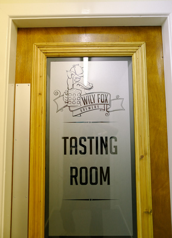 Wily Fox logo on the door to the tasting room
