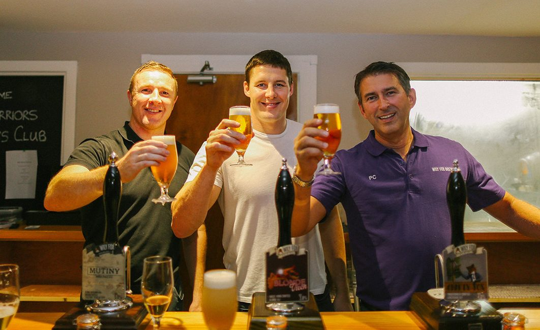 Kris Radlinski, Joel Tomkins & Phil Cox giving a 'cheers' after pulling a glass of beer