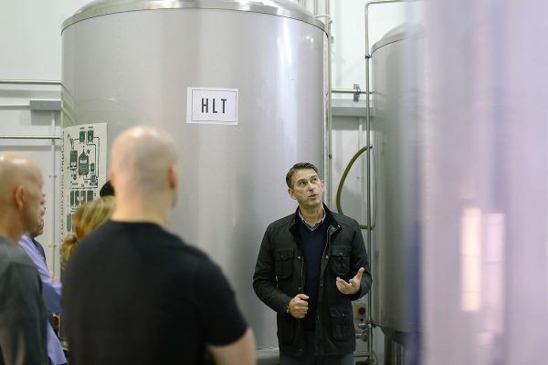 man giving a tour of the brewery