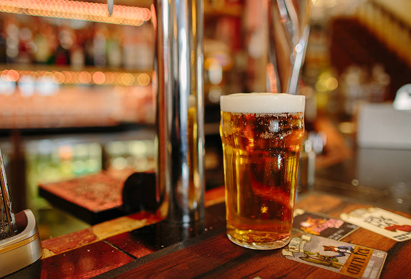 pint of golden beer on a bar